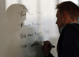 Steve Callan, director of technology at Hill Holliday writes on a whiteboard during an internal digital team meeting at their office in Boston. Jessica Rinaldi/Globe Staff